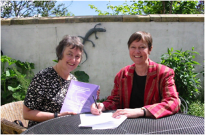 Liz Barber, GMPTE   signs GMPTE agreement with , Sarah Drake , first paid transport organiser.